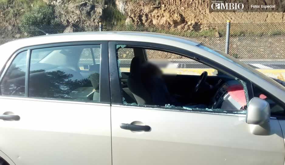 Tras ser baleado choca contra muro de contención en la México-Puebla