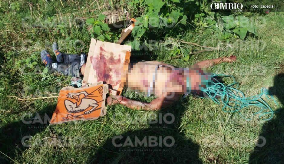 Con soga en el cuello y torturado abandonan cadáver en Almecatla, lo taparon con caja de pizza (VIDEO)