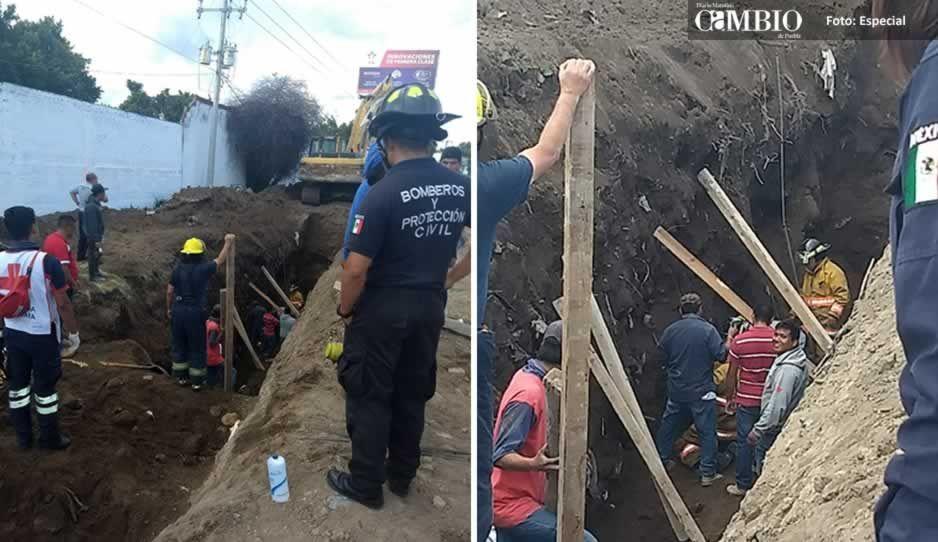 Quedan atrapados dos trabajadores tras colapsar obra de drenaje en bulevar de Atlixco