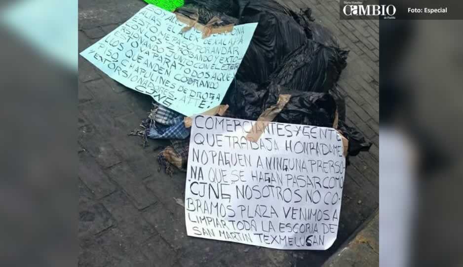 Abandonan restos humanos en ocho bolsas con narcomensajes en Texmelucan