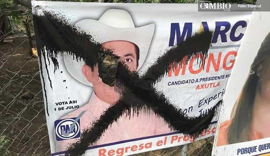 Tapan propaganda de campaña del candidato del PAN en Axutla