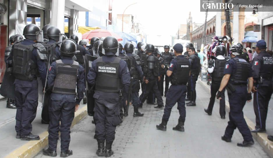 Vinculan a proceso a los 124 polis cachirules de Texmelucan
