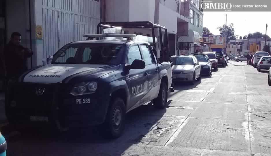 Con policías municipales, estatales y agentes de investigación resguardan IEE en Texmelucan