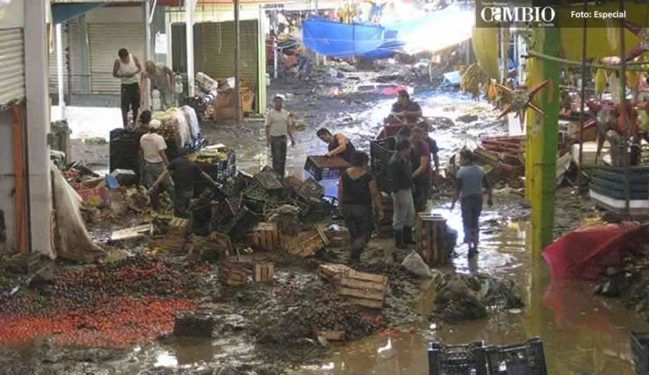 Tras inundación de hace seis años, comerciantes de Texmelucan siguen sin alarmas ni muro