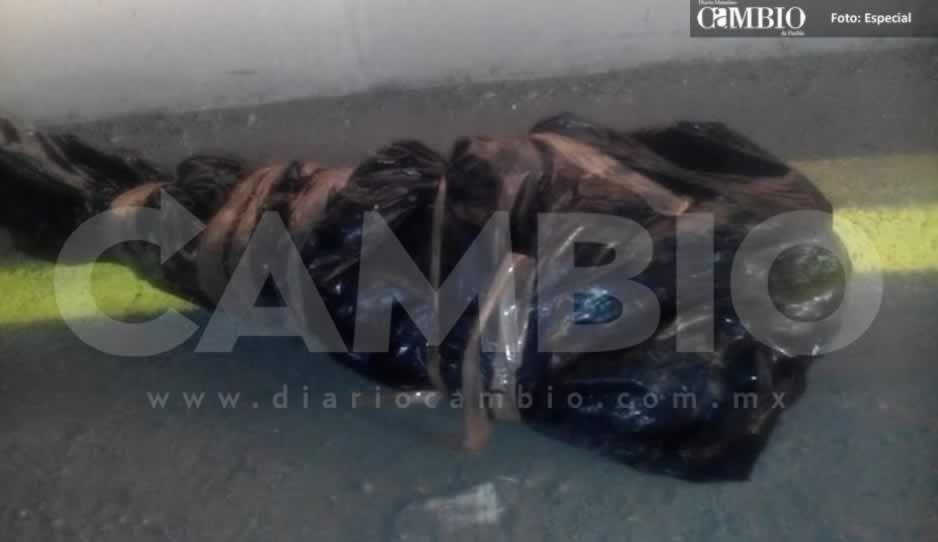 Hallan cadáver embolsado en camino a la ex hacienda de Chautla