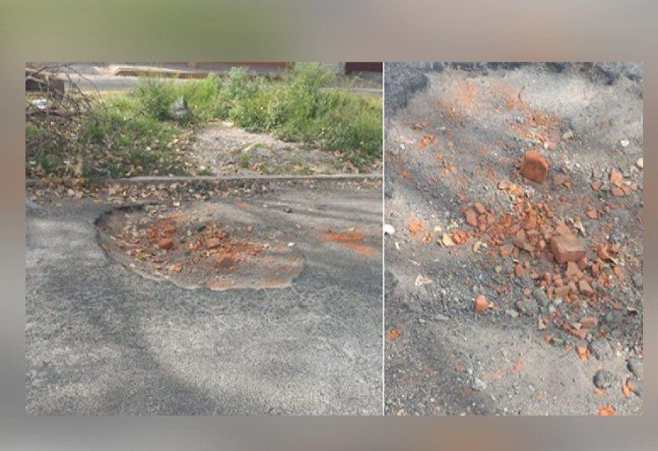 Al no recibir atención del ayuntamiento, vecinos intentan tapar baches con piedras