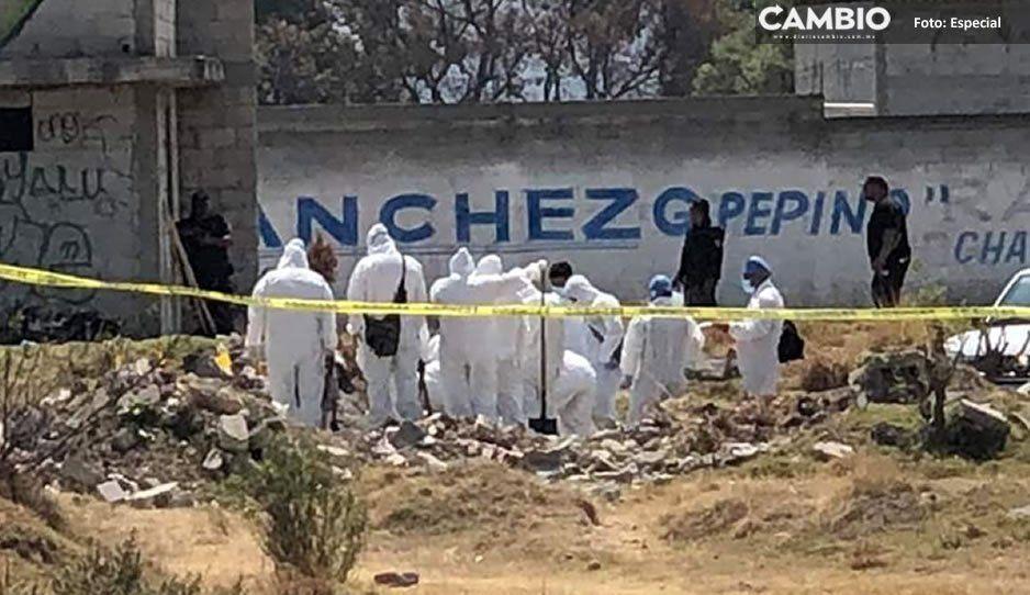 En camión de volteo tiraron los 8 cadáveres en el baldío de Amozoc