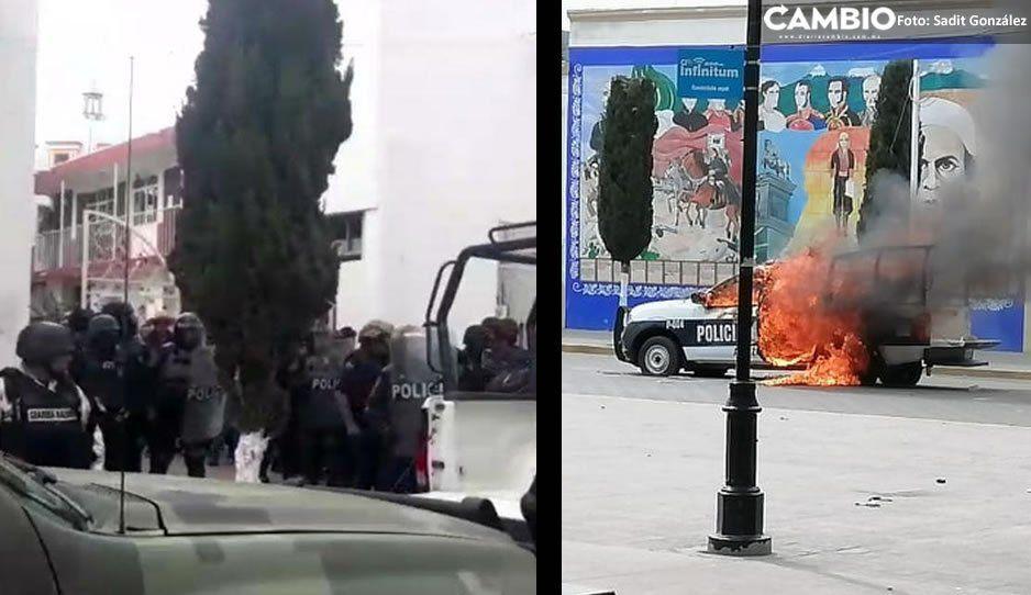 Guardia Nacional rescata al alcalde de Amozoc de turba enardecida que quemó patrullas