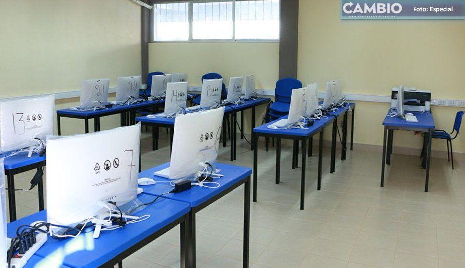 Atracan dos escuelas en Texmelucan; roban más de 20 computadoras y someten a las maestras