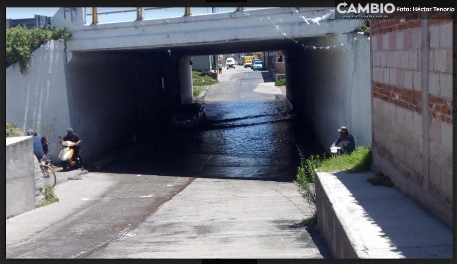 Vecinos piden a PC de Texmelucan retirar agua de puentes inundado