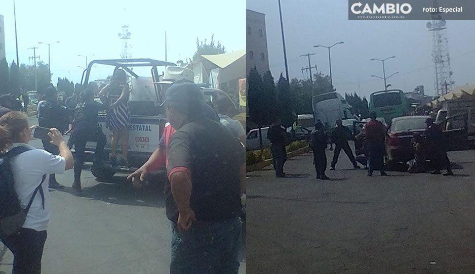 Policías estatales aseguran a tres con arma de fuego en Texmelucan