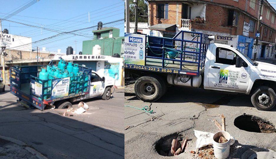 """Multan a camión por """"no fijarse"""" y caer en socavón, pero la culpa la tiene Agua de Puebla"""