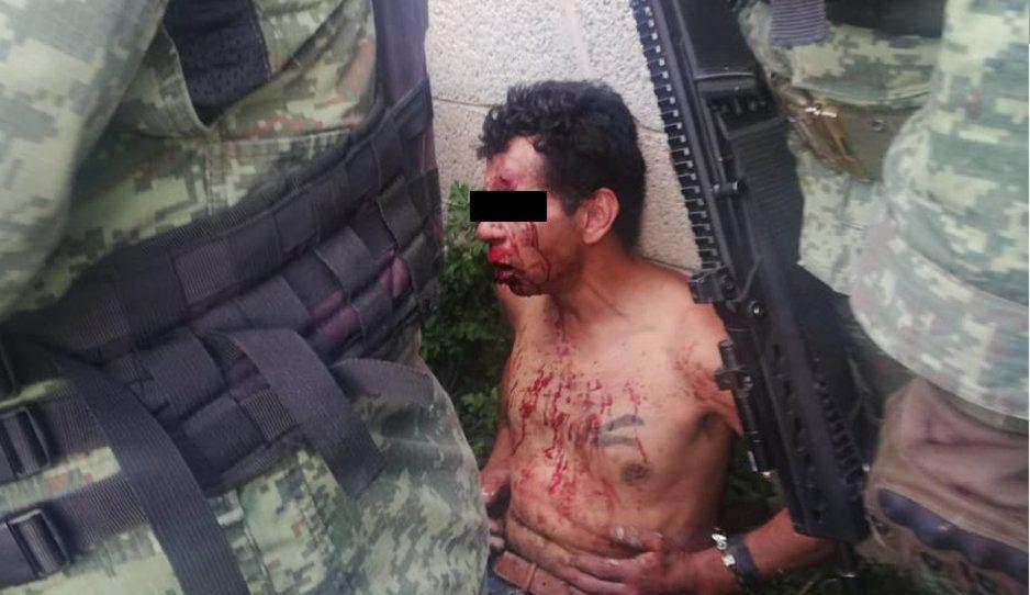 Vecinos de Tlahuapan desangran a rata y atacan a la Guardia Nacional (FOTOS y VIDEO)