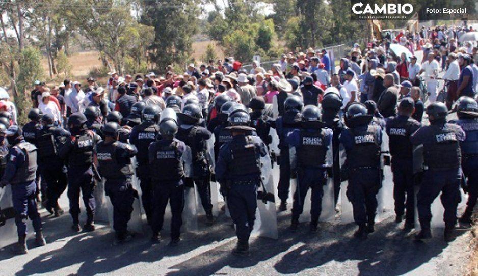 Vecinos de Juan C Bonilla logran  suspensión de drenaje tras bloqueo