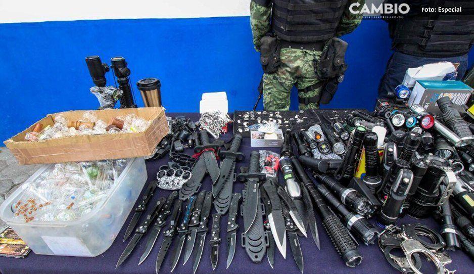 Decomisan chuchillos, chalecos antibalas, cascos de guerra y tasers en La Fayuca
