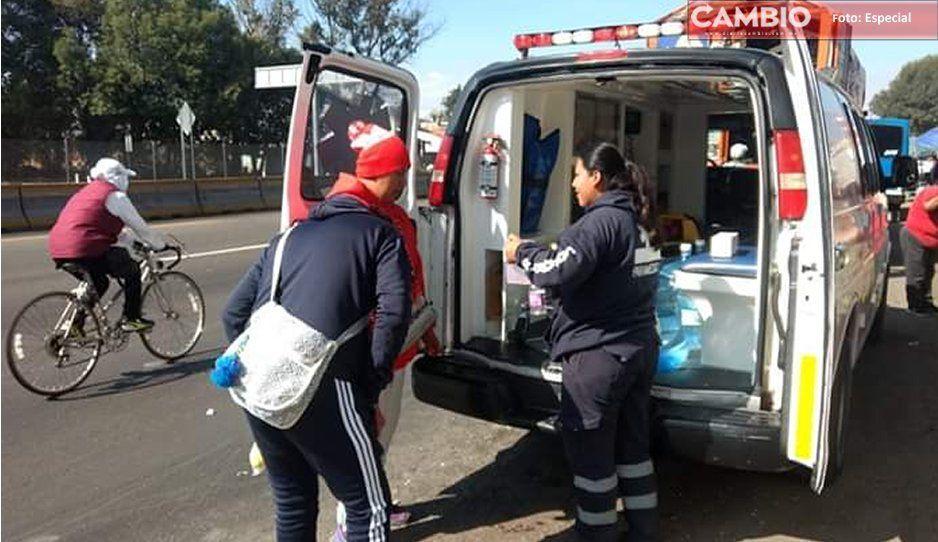 ¡Para que lleguen con bien! Paramédicos de PC auxilian a peregrinos que pasan por Texmelucan