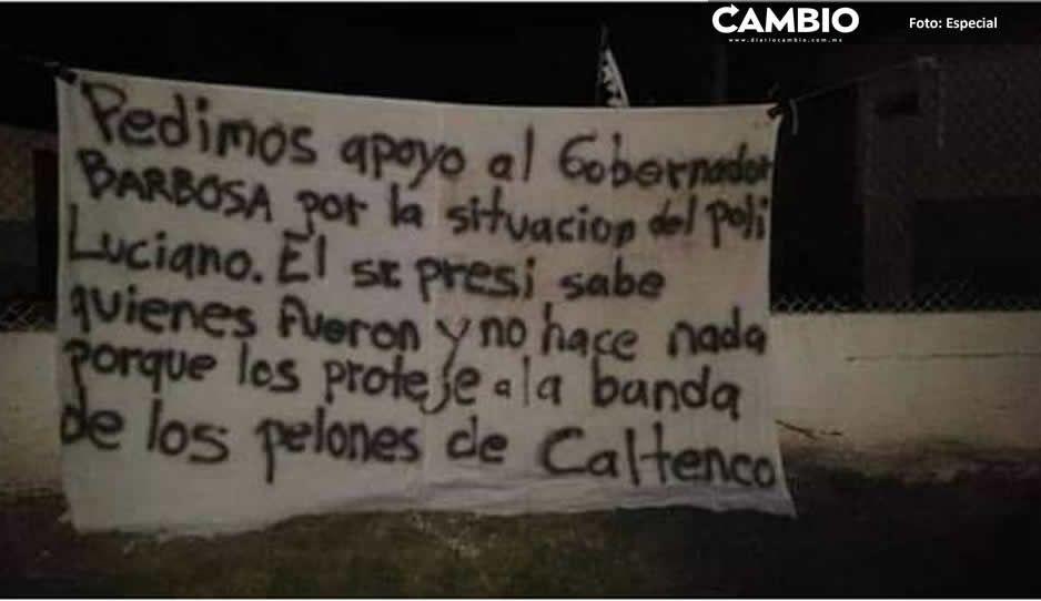 Mantas exhiben presuntos nexos del alcalde  de Tochtepec con la banda de Los Pelones