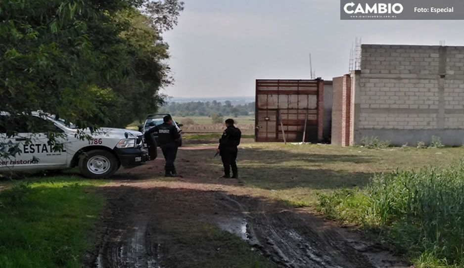 Policías estatales y municipales resguardan bodega asegurada en Texmelucan