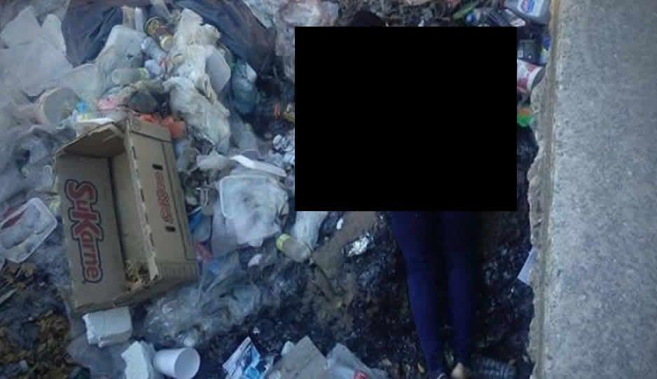 Cuerpo de mujer en basurero