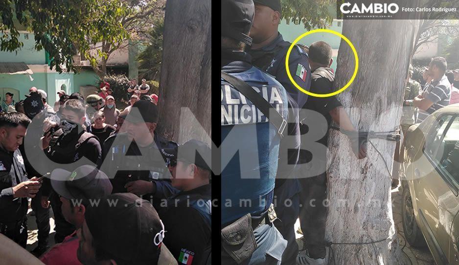 Golpean y amarran a un árbol a sujeto acusado de fotografiar niños afuera de una escuela en Tlahuapan