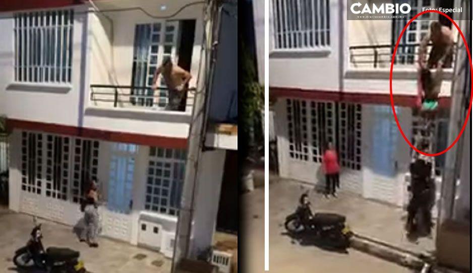 VIDEO: Jóvenes ayudan a escapar a la amante del vecino; así bajó del balcón