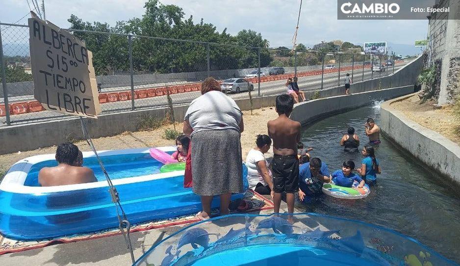 ¡Cuanta inocencia! Viralizan FOTO de niñitos bañándose en Canal de Atlacomulco
