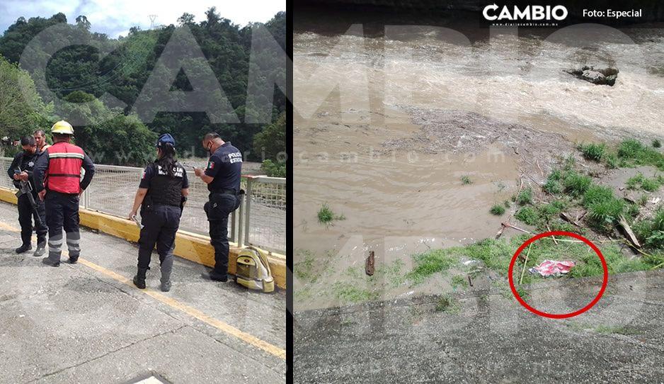 Hallan el segundo cuerpo de los tres hombres que se tragó el río en Tlatlauquitepec