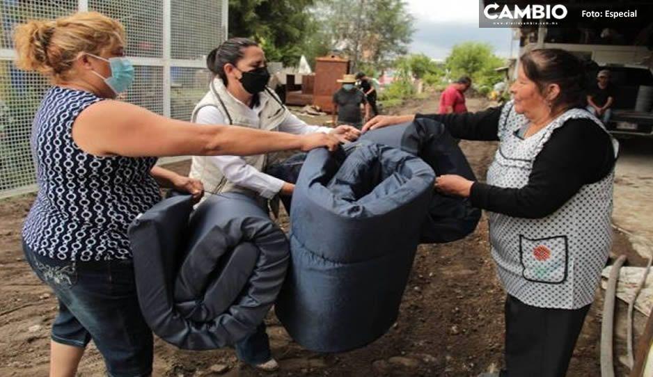 Entregan apoyos a familias afectadas por lluvias en San Pedro Cholula