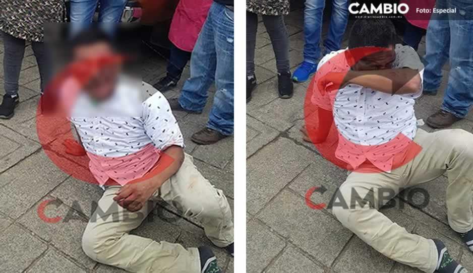 ¡Casi lo linchan! Justicieros dan tremenda golpiza a ladrón en mercado de Huauchinango (VIDEO)