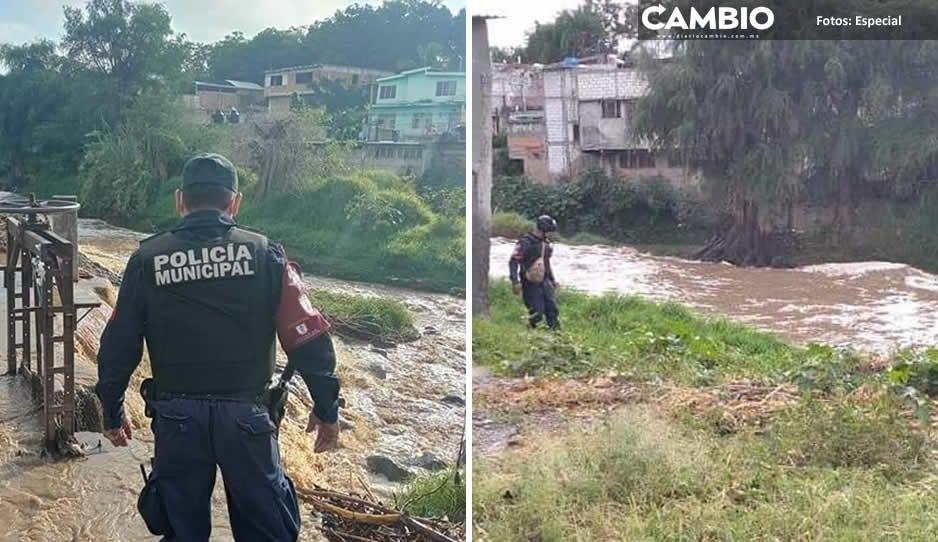 Denuncian vecinos cuerpo sin vida de una mujer flotando en el Rio Nexapa, pero no logran rescatarlo