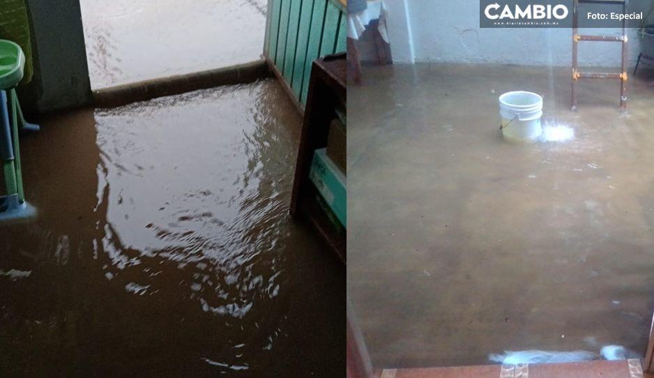 FOTOS: Reportan inundaciones de casas en Bosques de Amalucan