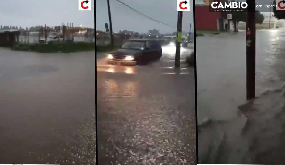 VIDEOS: Aguacero provoca inundaciones en Cholula; vecinos piden mantenimiento a alcantarillas