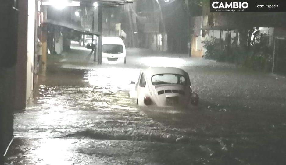 ¡Fuerte tromba azota Xicotepec! Se inundan viviendas y comercios, las calles parecían ríos (FOTOS)